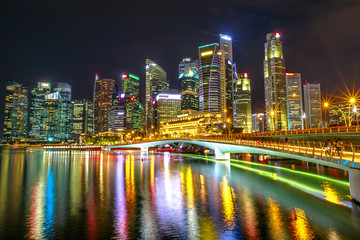 Singapore financial buildings and skyscrapers of downtown reflected in the sea of the harbor. Singapore skyline by night. Night scene waterfront marina bay.