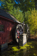 An Old Wooden Water Mill by a Pond