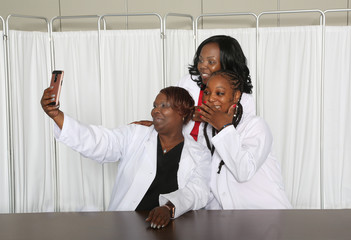 Good, Happy Moments with three women medical professionals, friendship among three girls, taking a selfie moment