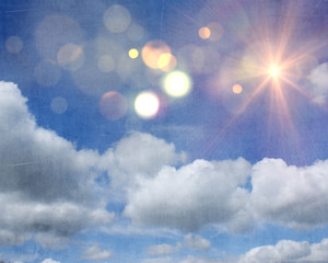 Grunge sunshine and clouds on blue sky background
