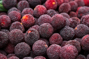 Assortment of Red YangMei Berries from China. Also known as bayberries in some countries