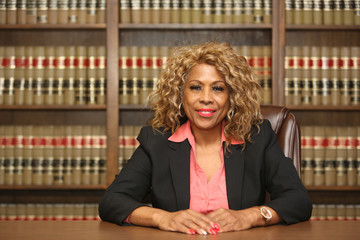 Portrait of an attractive African American woman. Woman lawyer inside law office.