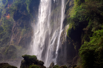 Powerful Waterfall - Nature Background Images, Jagged Rocks/Cliffs and Lush Green Trees. Fast Flowing Water