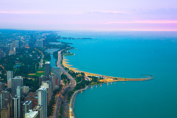 Wall Mural - View of Chicago Illinois and Lake Michigan with beaches, buildings and roads in view at sunset