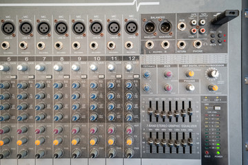 Sound technician audio mixer equalizer control for background.