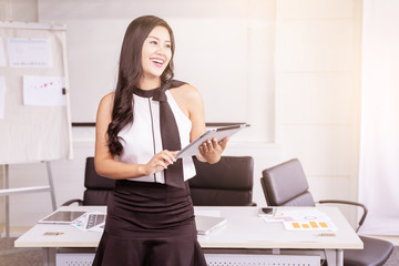Smile of modern business woman hand holding tablet in the office with copy space.