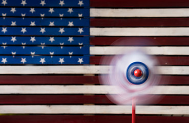Pinwheel or whirligig in front of US flag