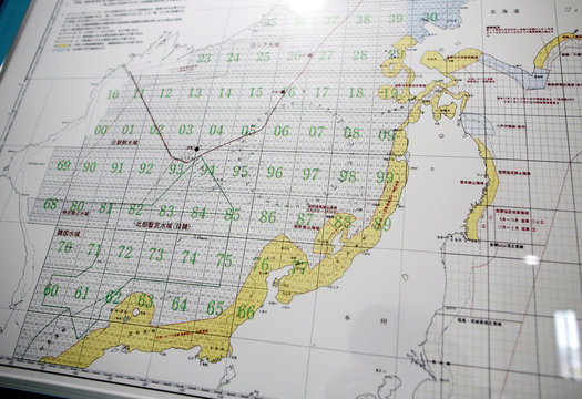 A map showing waters between Japan and the Korean Peninsula is displayed at a squid-processing plant in Sakata