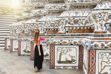 Wall Mural - Woman tourist is enjoy sightseeing inside Wat Arun temple in Bangkok, Thailand.