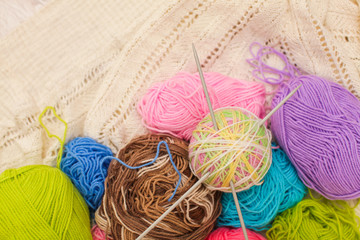 Knitting needles, colorful threads. colorful yarn wool, Knitting background, a lot of balls, selective focus
