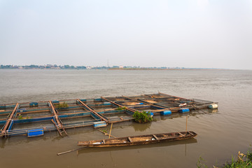 The bamboo coop for feeding fish in Mekong river