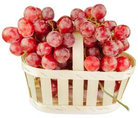 Wall Mural - panier de raisins rosés, fond blanc
