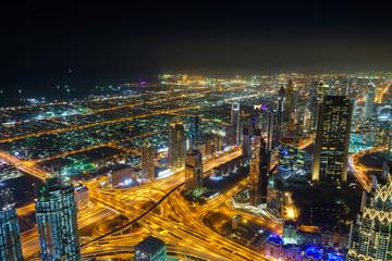 Night view of Dubai skyscrapers at financial district from Burj Khalifa. Dubai, United Arab Emirates