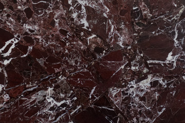 The red marble. Texture.