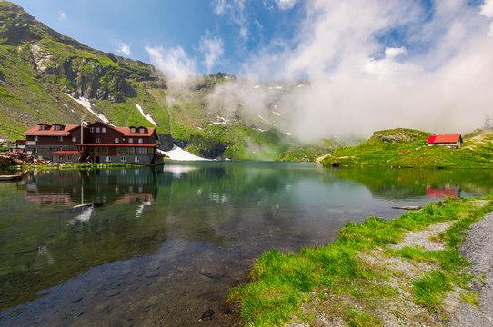 area of lake Balea in clouds. Gorgeous summer landscape of Fagarasan mountains, Romania. popular tourist location