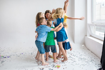 happy hugging children on the white background