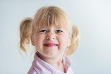 Little happy girl portrait on white background