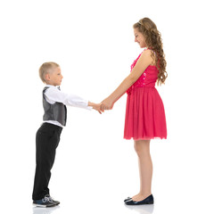 A boy and a girl are holding hands.