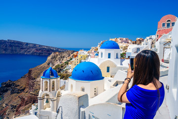 Famous blue domes of Santorini photographed by tourist - focus on domes, Greece