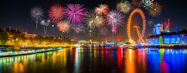 Panorama of Thames river in London with fireworks. Celebration of the New Year in London, UK  Wall mural