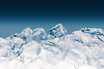 Pieces of crushed ice cubes on blue background. Clipping path included