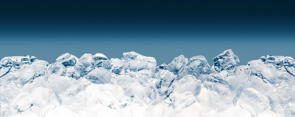 Pieces of crushed ice cubes on blue background. Clipping path included.