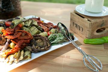fresh italian antipasti starter buffet with herbs