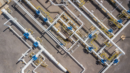 Aerial top view natural gas pipeline, gas industry, gas transport system, stop valves and appliances for gas pumping station.