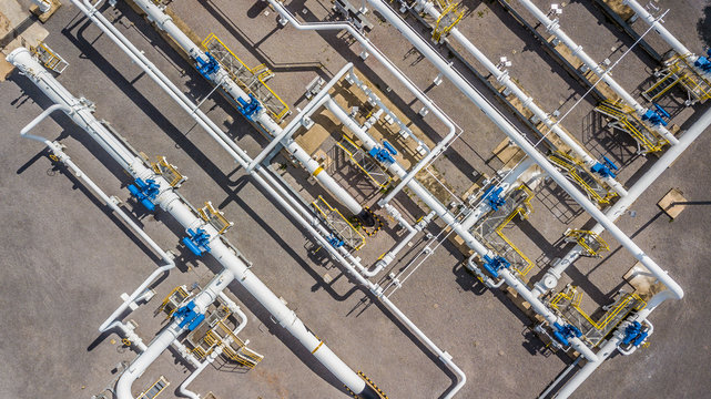 Aerial top view natural gas pipeline, Business gas industry, Construction gas transport system, stop valves bolt and appliances for gas pumping station capacity chemical.
