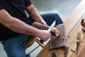 man making three tealight candle holders from rustic wood
