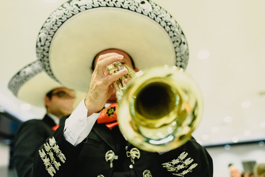 Mexican musician with his trumpet and guitars