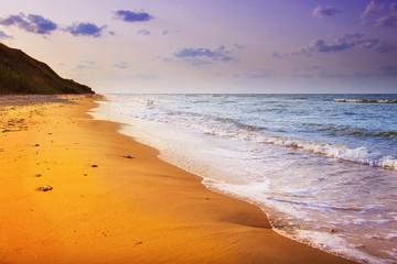 yellow sand beach near the blue beautiful sea