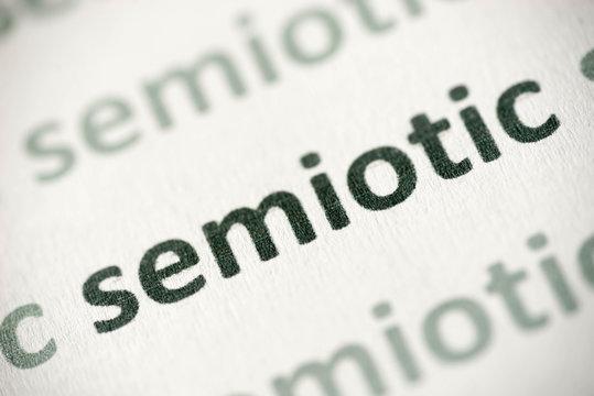word semiotic printed on paper macro