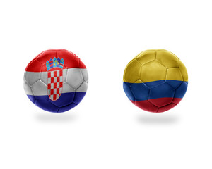 football balls with national flags of colombia and croatia.