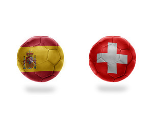 football balls with national flags of switzerland and spain.