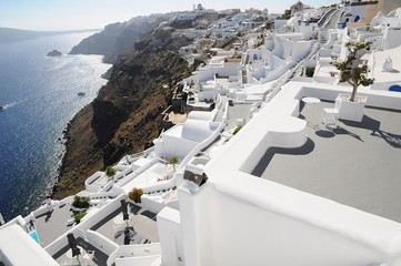 Famous stunning view of white architectures and colors above the volcanic caldera in the village of Oia in Santorini island, Greece