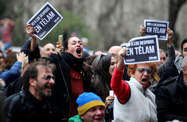 Workers of the Argentina's national news agency Telam, who were dismissed last week, react during the broadcast of the FIFA World Cup soccer match between Argentina and France in Buenos Aires
