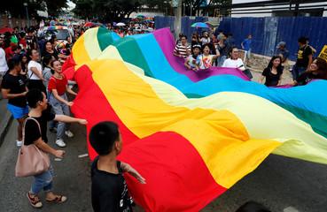 inMembers of LGBT community display a huge rainbow colour flag during a Gay Pride parade in Marikina, Metro Manila