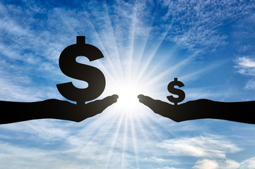 Silhouette of two hands, one holding a large sign Dolar having a large income, the other small