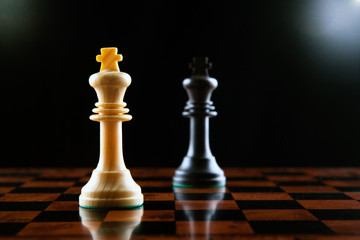 chess duel of two kings on a black background