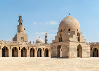 Courtyard of Ibn Tulun public historical mosque, Cairo, Egypt. View showing the ablution fountain, the minaret and the minaret of Sarghatmish mosque