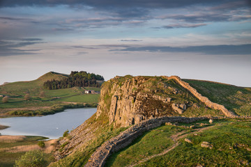 Beautiful landscape image of Hadrian's Wall in Northumberland at sunset with fantastic late Spring light