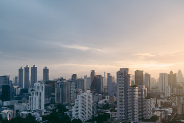 Bangkok cityscape after the rain in the evening with sun going down.
