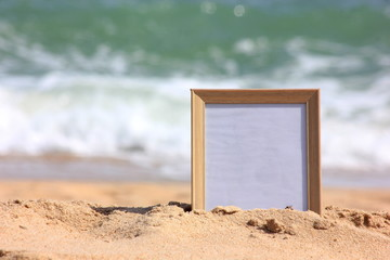 Wooden picture frame on the beach sand, Copy space,summer concept.