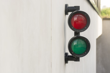 Red and Green Light on white concrete at Parking Garage