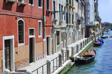 Grand canal famous landmark panoramic view Venice Italy with blue sky white cloud and gondola boat water. Beautiful architecture  Venice, Italy.