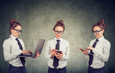 Happy woman working using multiple devices