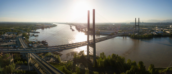 Aerial view of Alex Fraser Bridge during a vibrant sunny day. Taken in North Delta, Greater Vancouver, BC, Canada.