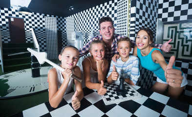 Positive family is visiting of escaperoom