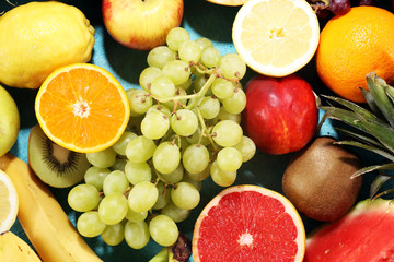 Fresh organic fruits background. Healthy eating concept.